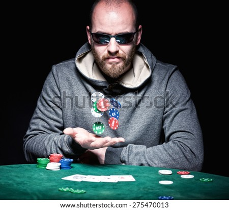 poker player with sunglasses play with chips - stock photo