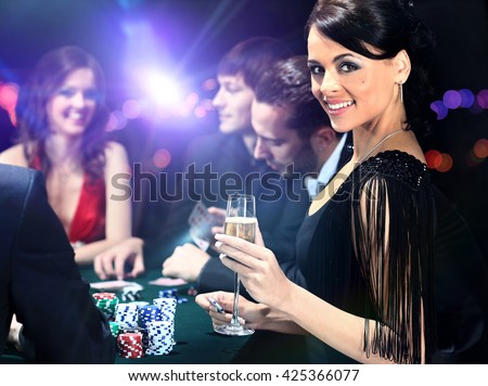 Poker players sitting in casino - stock photo