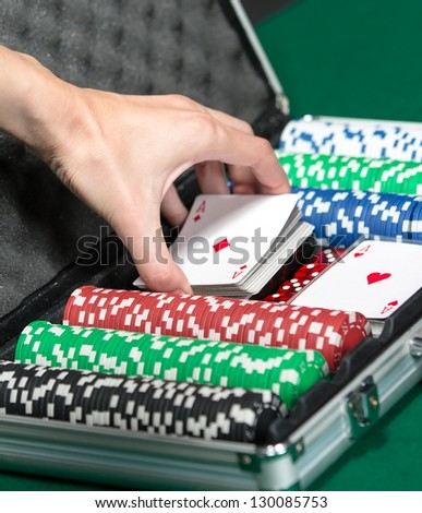 Poker set in metal suitcase. Addiction to the gambling - stock photo