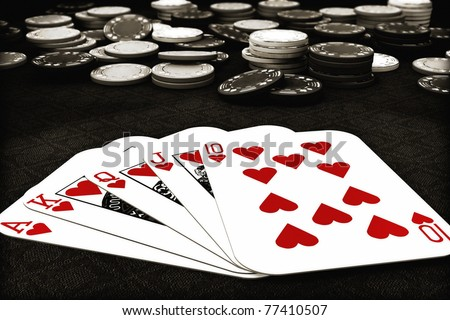 Poker suit Royal Flush of  hearts colored with depth of field poker chips in background , 300 D.P.I - stock photo