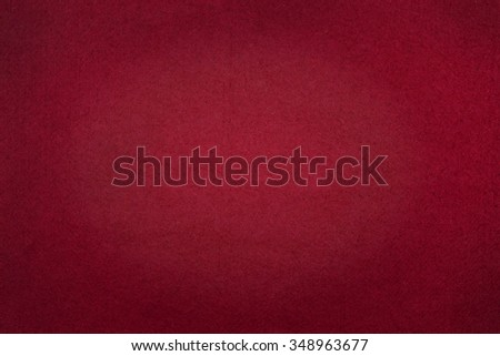 Poker table felt background in red color - stock photo