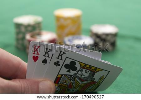 Poker, three kings and gambling chips - stock photo
