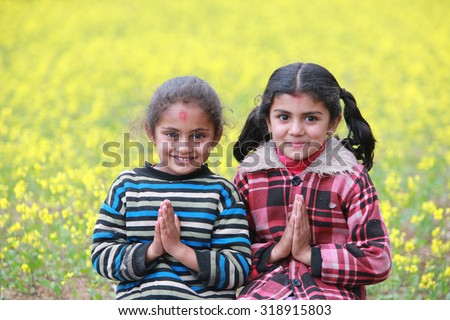 POKHARA, NEPAL, Feb 18 : welcome gesture of hands by two young Nepali girls  at Pokhara on Feb 18, 2015 - stock photo