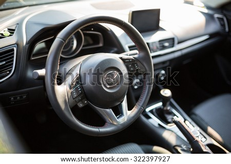 POLAND - AUGUST 9, 2015: Interior of new Mazda 3 captured with low depth of field technique. Mazda 3 is a popular compact car manufactured in Japan by the Mazda Motor Corporation. - stock photo