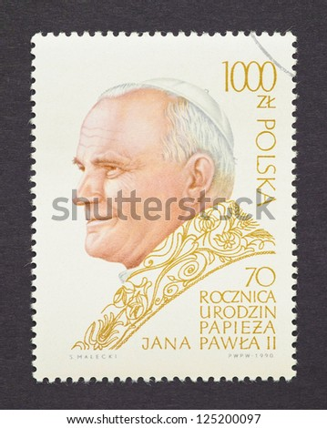 POLAND - CIRCA 1990: a postage stamp printed in Poland showing an image of Pope John Paul II, circa 1990. - stock photo