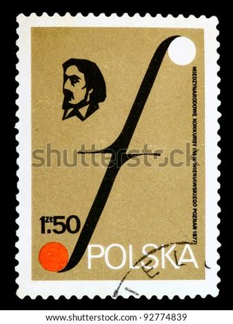 POLAND - CIRCA 1977: A stamp printed in Poland shows portrait Henryk Wieniavski and Musical Symbol. Wieniavski Music Festivals. Poznan, circa 1977 - stock photo