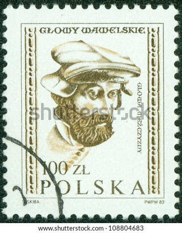 POLAND - CIRCA 1982: A stamp printed in the Poland, shows a male head of the embassy of the hall of the castle Wawel in Krakow, circa 1982 - stock photo