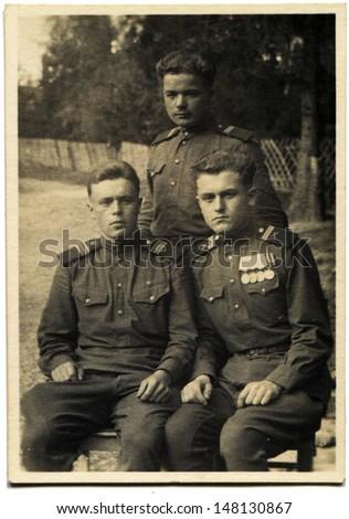 POLAND - CIRCA MAY 16, 1950: Vintage photo shows three Soviet Army sergants, Poland, May 16, 1950 - stock photo