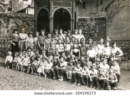 POLAND, CIRCA 1970's: Vintage photo of group of classmates and teachers posing together  during a school excursion - stock photo