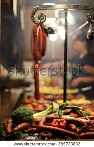 POLAND. Krakow sausages with vegetables on fair. - stock photo