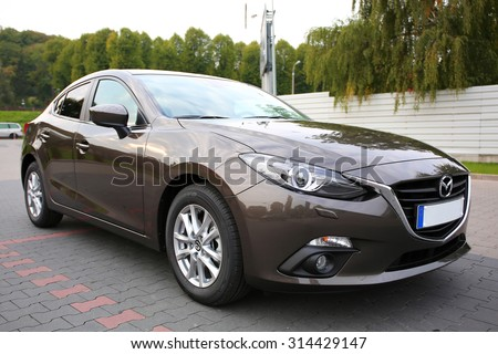 POLAND-SEPTEMBER 24, 2014: New Mazda 3 at the parking side in Poland. Mazda 3 is a popular compact car manufactured in Japan by the Mazda Motor Corporation. - stock photo