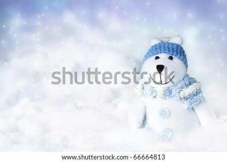 Polar bear toy in snow - stock photo