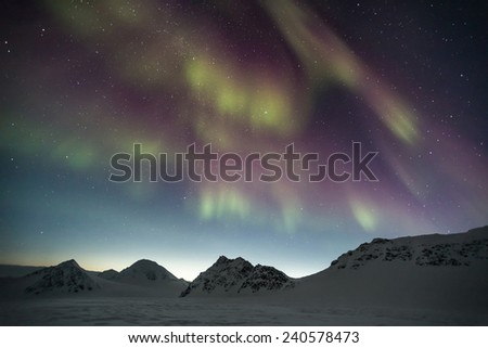 Polar night with Northern Lights on the sky - Arctic landscape - stock photo