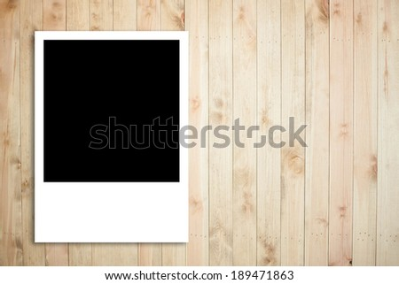 Polaroid photo frame on wood plank background, long shape of photo frame - stock photo