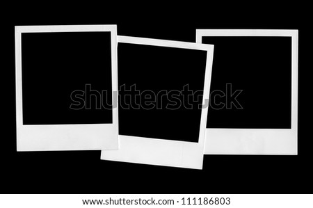 polaroid photo frames on black background - stock photo