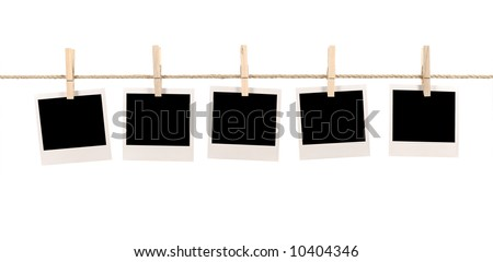 Polaroid string : several blank polaroid style instant camera photo prints hanging on a rope or string isolated on a white background.  Space for copy.  Polaroid frame, instant photo. - stock photo