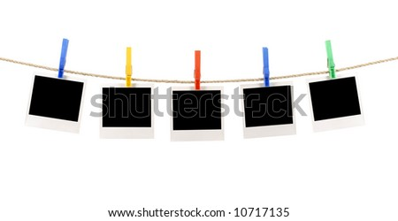 Polaroid string : several blank polaroid style instant camera photo prints hanging on a rope or string isolated on a white background.  Polaroid photo frame, instant print.  Space for copy. - stock photo