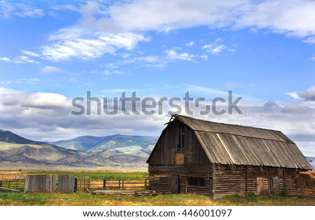 Pole barn sits with view of Gallatin Mountains in Happy Valley, Wyoming.   - stock photo
