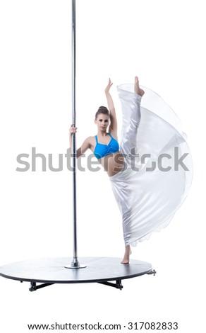 Pole dance. Flexible woman posing at camera - stock photo
