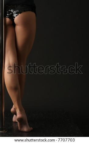 Pole dancing exercise - stock photo