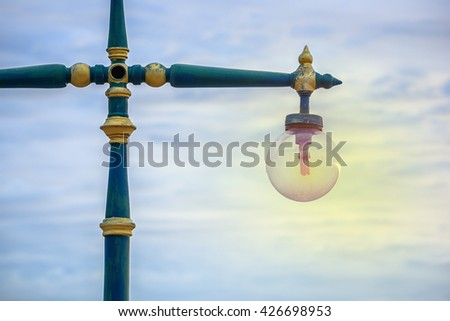 Pole lamps at dawn with blue sky. - stock photo