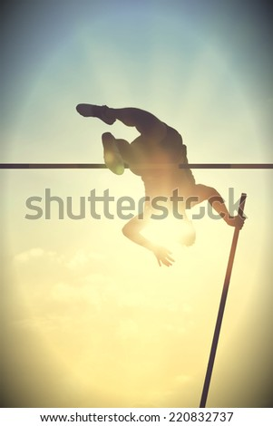 Pole vault over the bar with  back light. Vintage version - stock photo