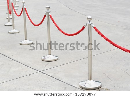 pole with red rope  - stock photo