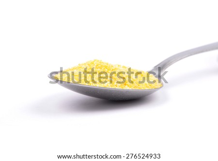 Polenta on spoon - stock photo