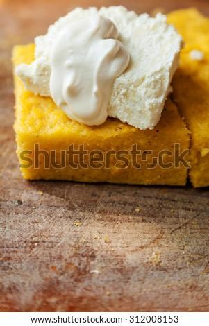 Polenta with cheese and cream - stock photo