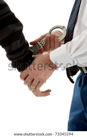 police agent is making a arrest in closeup over white background - stock photo