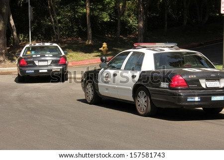 Police at a protest involving Casey Kasem's children, brother and friends who want to see him but have been denied any contact,  Private Location, Holmby Hills, CA 10-01-13 - stock photo