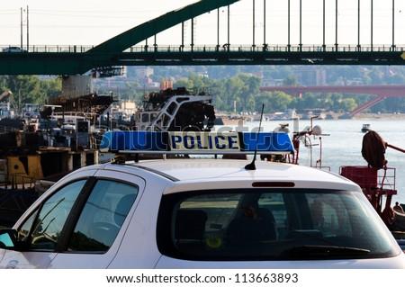 Police car near the river - stock photo