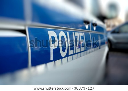 police car on the roadside during a police operation - stock photo