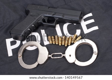 police concept with gun ammo and handcuffs - stock photo