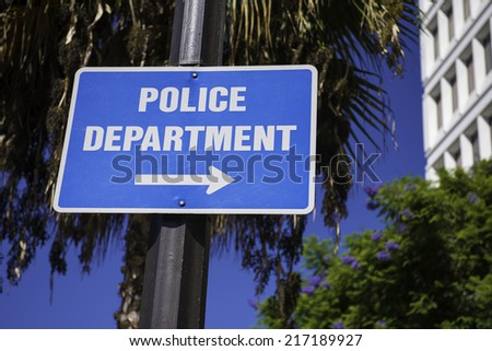Police Department sign directing you to the Police Department - stock photo