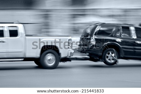 police department tow truck delivers the damaged vehicle and blue tonality - stock photo