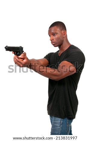 Police detective man on the job with a gun - stock photo