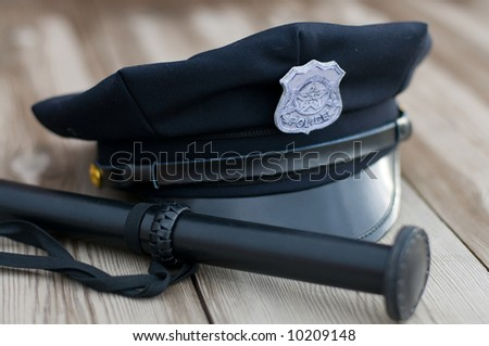 Police equipment. Hat and truncheon - stock photo