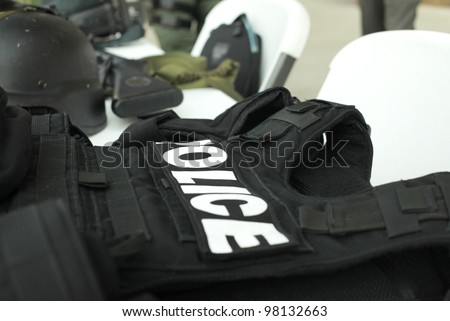 Police Equipment sitting on table for demonstration - stock photo