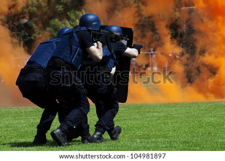 Police force in anti terrorist action - stock photo