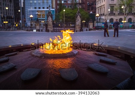 Police guards Centennial Flame & Peace Tower in Parliament building complex Ottawa - stock photo