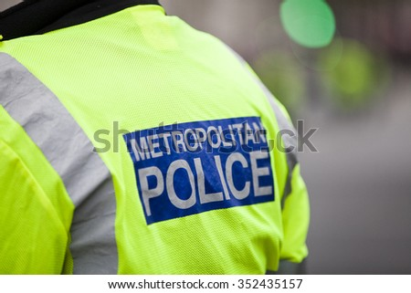 Police in hi-visibility jackets policing crowd control at a London event - stock photo