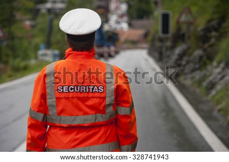 Police in hi-visibility jackets, securitas traffic control on the road. - stock photo