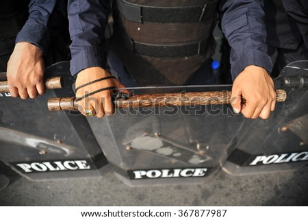 Police in Riot Gear Carrying Batons Background - stock photo