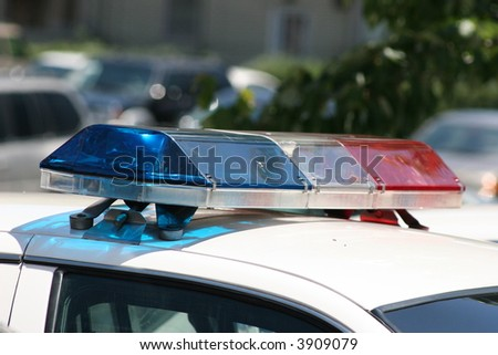 Police lights atop a police car. - stock photo