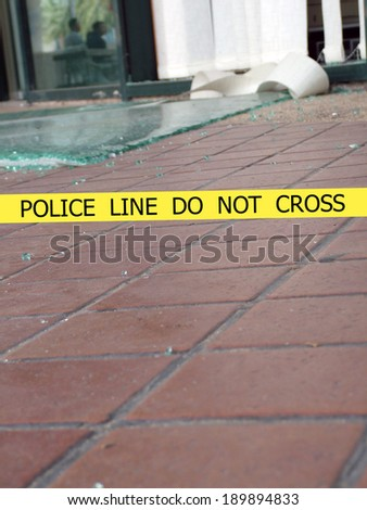 Police line do not cross sign tape on damaged by explosion  building background - stock photo