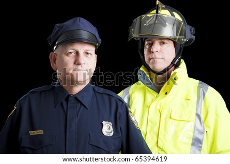 Police officer and fire fighter portrait on black. - stock photo