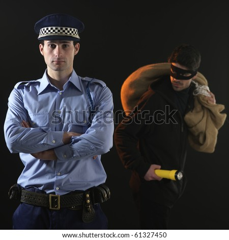 Police officer and thief. The policeman is distracted while the thief is stealing - stock photo