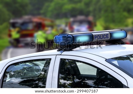 Police officer emergency service car driving street in the open road - stock photo