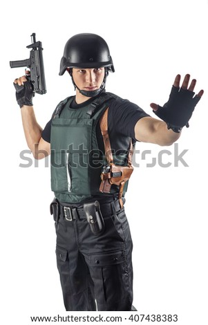 Police officer in body armour is holding a gun. Isolated on white. - stock photo